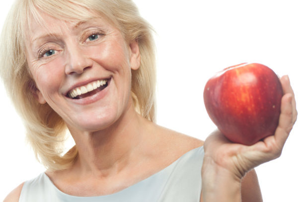 Mature woman holding an apple